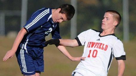 Northport's Brandon Deady, left, heads a ball away