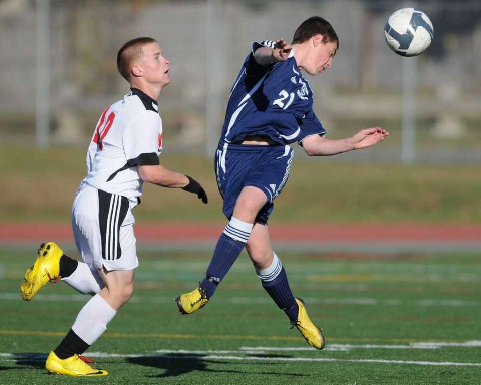 Northport's Brandon Deady, right, heads a ball away