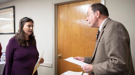 Laura Positano of Farmingville speaks with Jeremy Burwell,