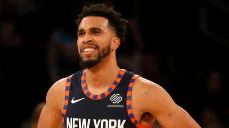 The Knicks' Courtney Lee looks on during the