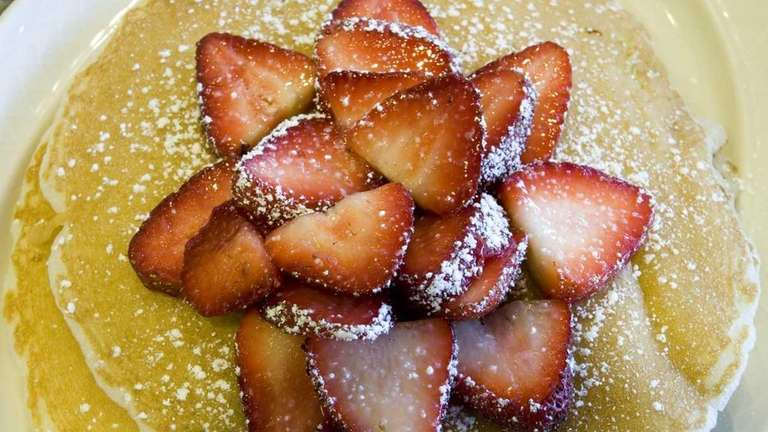 Angel food pancakes, with strawberries and powered sugar,