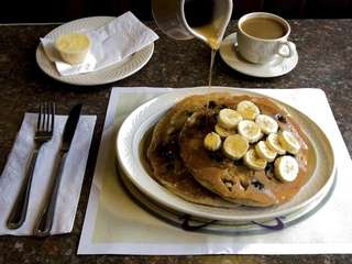 Syrup is poured over whole-wheat pancakes made with