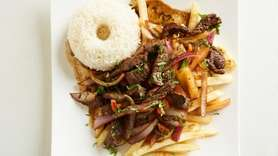 Lomo saltado (sauteed beef with onions and tomatoes)