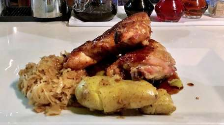 Roast chicken with choucroute garnie and potatoes is