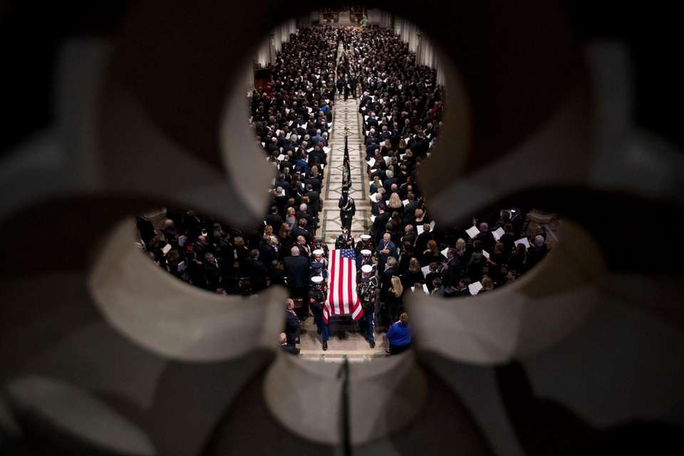 The flag-draped casket of former President George H.W.