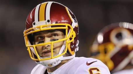 Redskins quarterback Mark Sanchez looks on during a