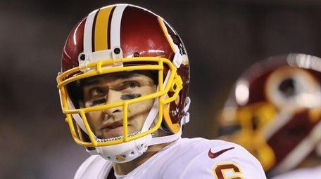 Redskins quarterback Mark Sanchez looks on during a