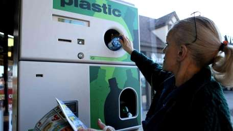 Kathy Maloney, of Massapequa Park, recycles plastic bottles