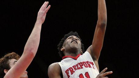 Jayden Bumpass #11 of Freeport, right, scores from