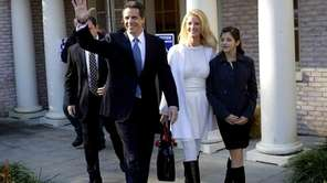 Gubernatorial candidate Andrew Cuomo waves as he exits