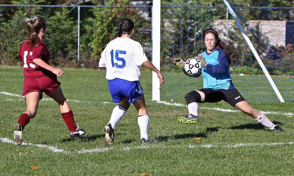 Whitman goalie Samantha Myers-Dineen makes a save on