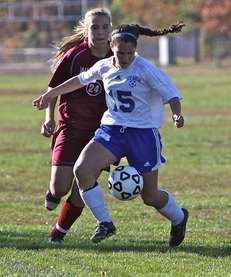 North Babylon forward Emily Ude gets past Whitman