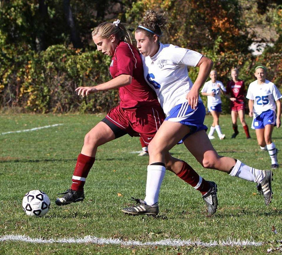 North Babylon defender Kelsey Hart, right, stays close