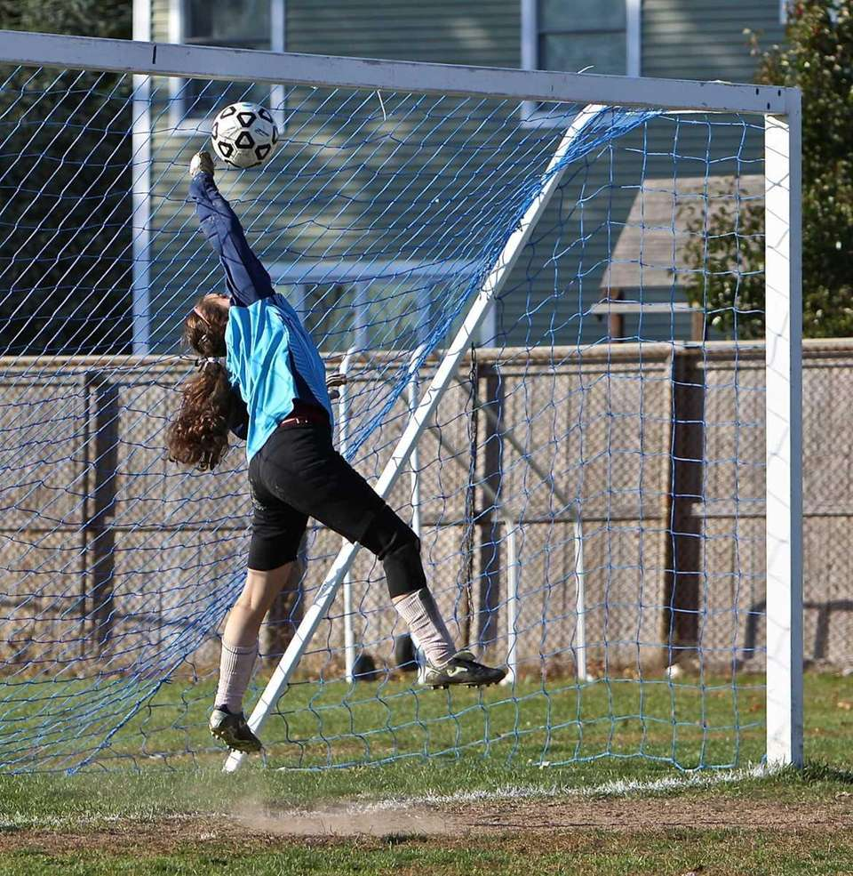Whitman goalkeeper Samantha Myers-Dineen leaps to make a