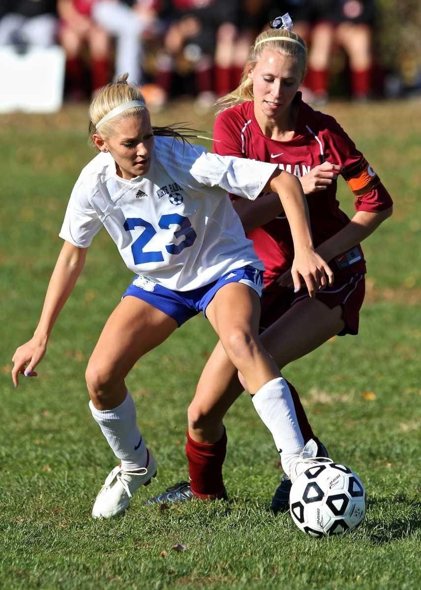 North Babylon midfielder Catherine Sandkuhl, left, battles with