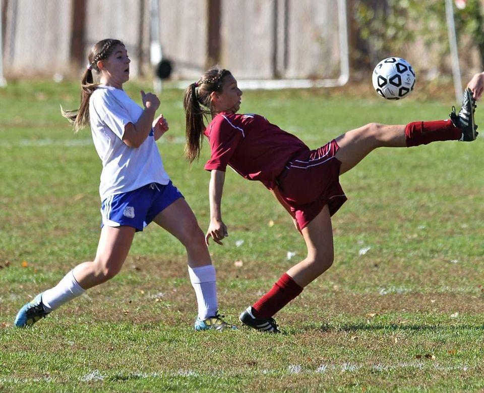 Whitman midfielder Samantha Servedio, right, sends the ball