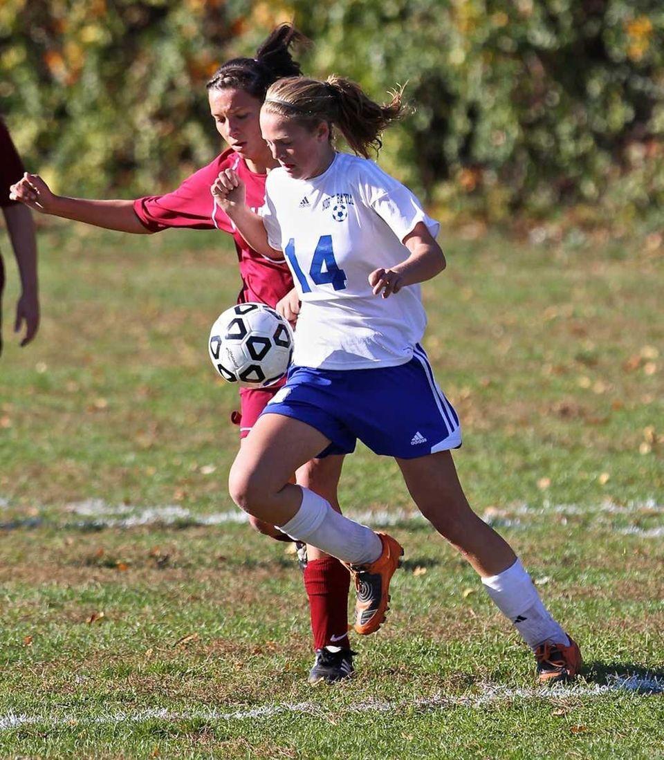 North Babylon midfielder Megan Binder, right, gets around