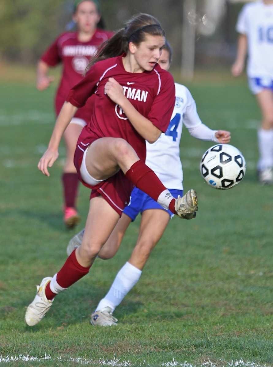 Whitman defender Julia Cranz kicks the ball away