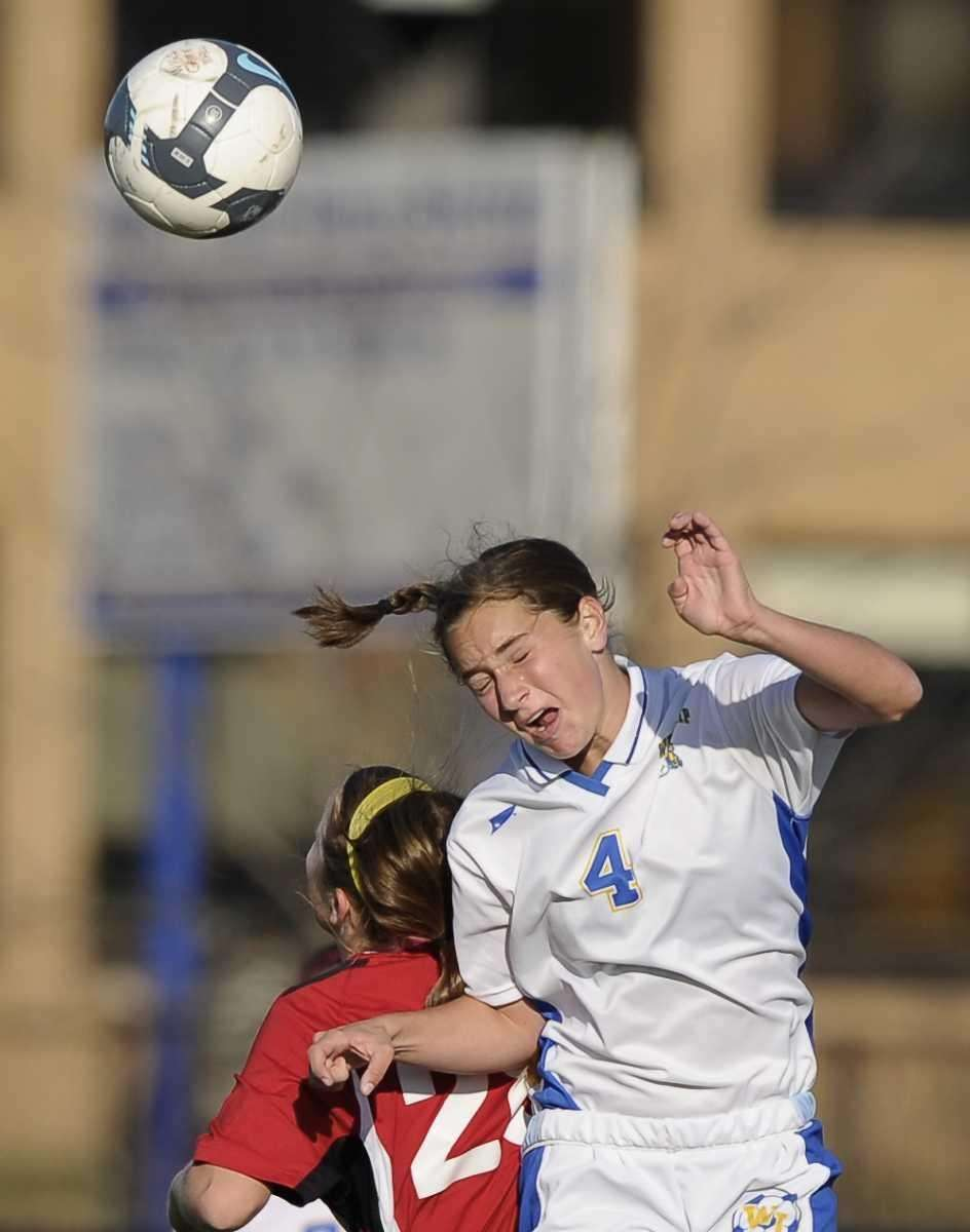 West Islip's Taylor LaRose goes up for a