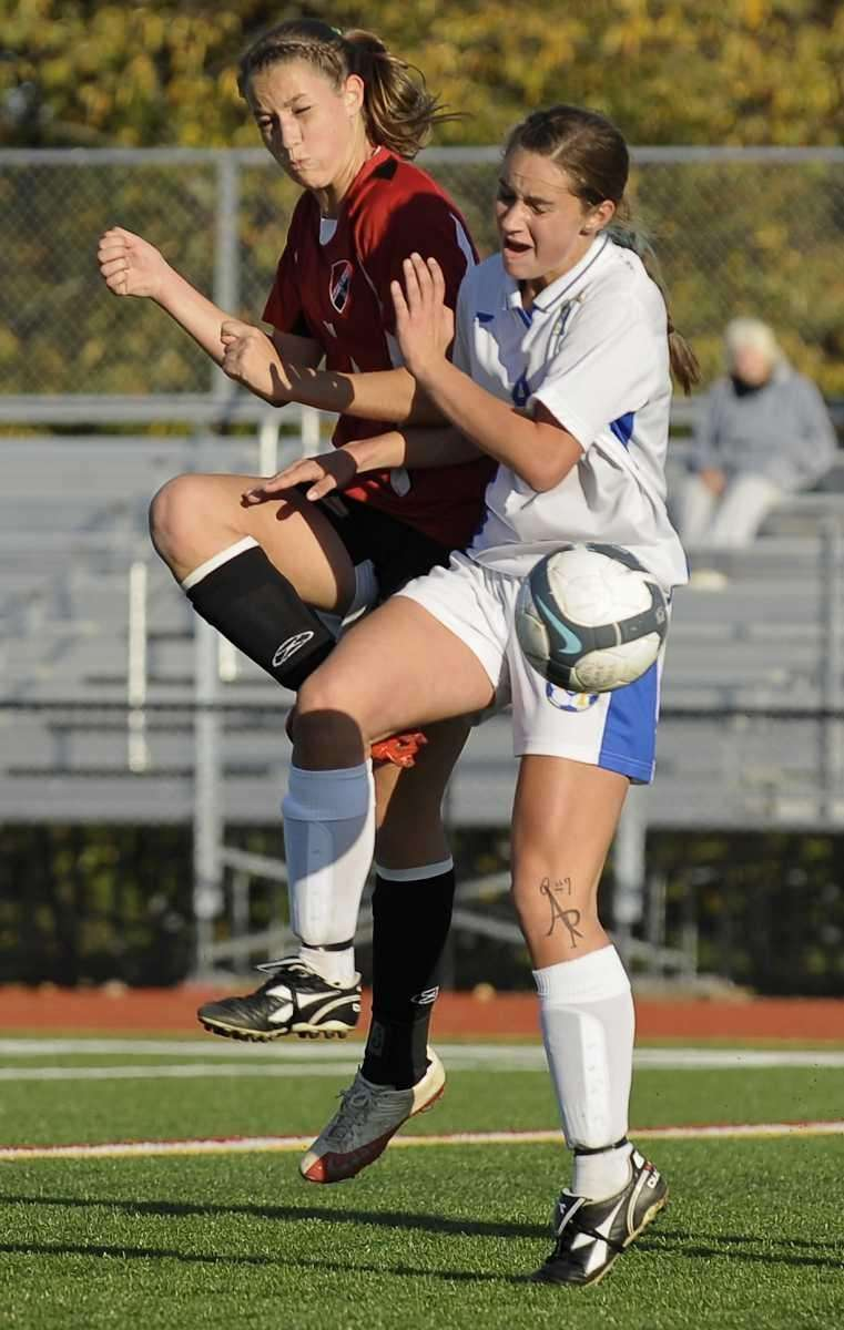 West Islip's Taylor LaRose, right, battles for the