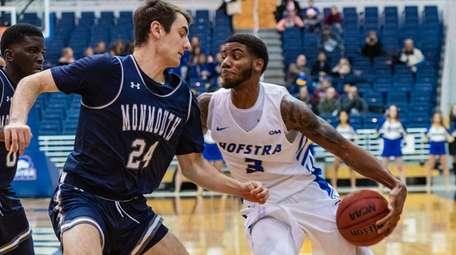 Hofstra guard Justin Wright-Foreman (3) works on Monmouth