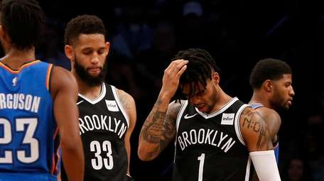 D'Angelo Russell #1 and Allen Crabbe #33 of