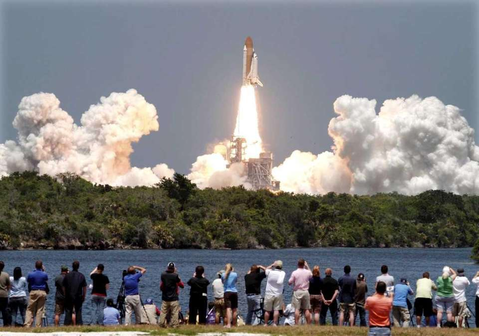 Space shuttle Atlantis lifts off from the Kennedy