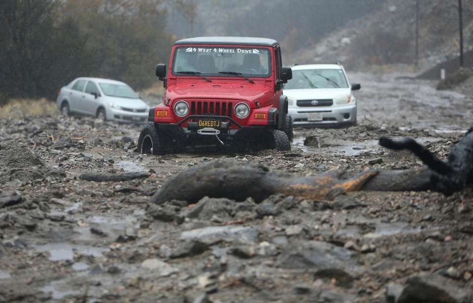A mudslide trapped several vehicles along Valley of