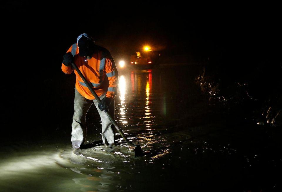 Butte County road worker Matt Brandt clears a