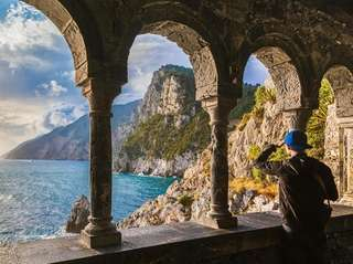 A young man enjoys a scenic view the
