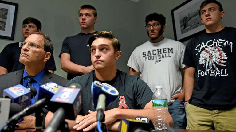Matthew Kmiotek, 17, speaks during a news conference