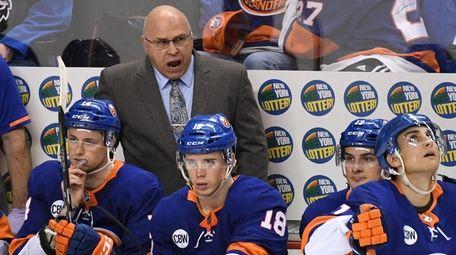 Islanders coach Barry Trotz reacts after the Washington