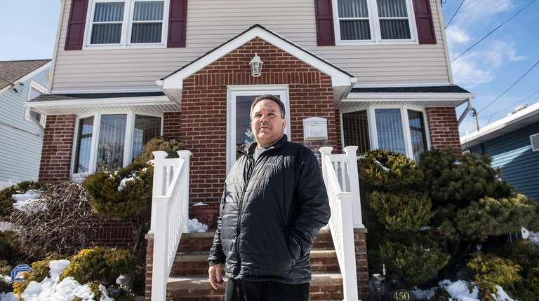 Pat Nicolosi, shown outside his home in Elmont