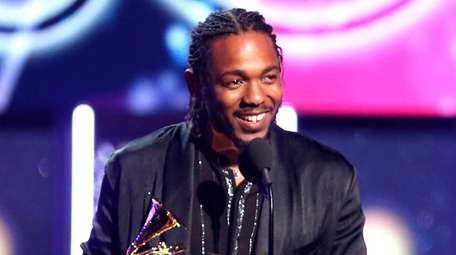 Rapper Kendrick Lamar accepts the award for best