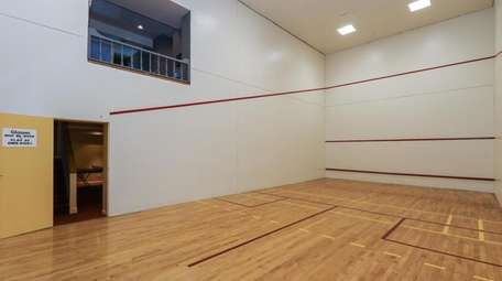 The previous owner installed the racquetball court.