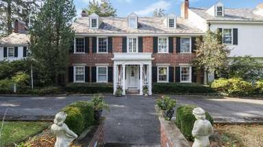 The six-bedroom, 5-1/2-bathroom center hall Colonial was built