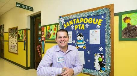 Matthew Amore of West Babylon helps decorates the