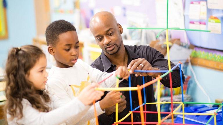 Michael Gittens helps his son Noah Gittens, 6,
