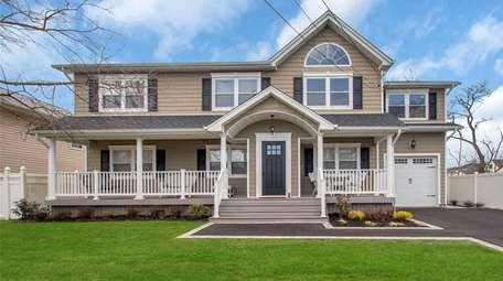This Colonial, listed for $979,888, has four bedrooms