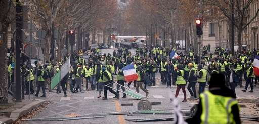 Demonstrators protest higher gas taxes in Paris last