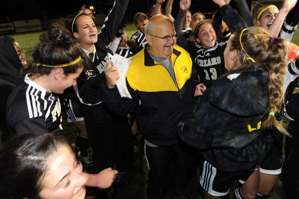 St. Anthony's coach Dave Prutting is surrounded by
