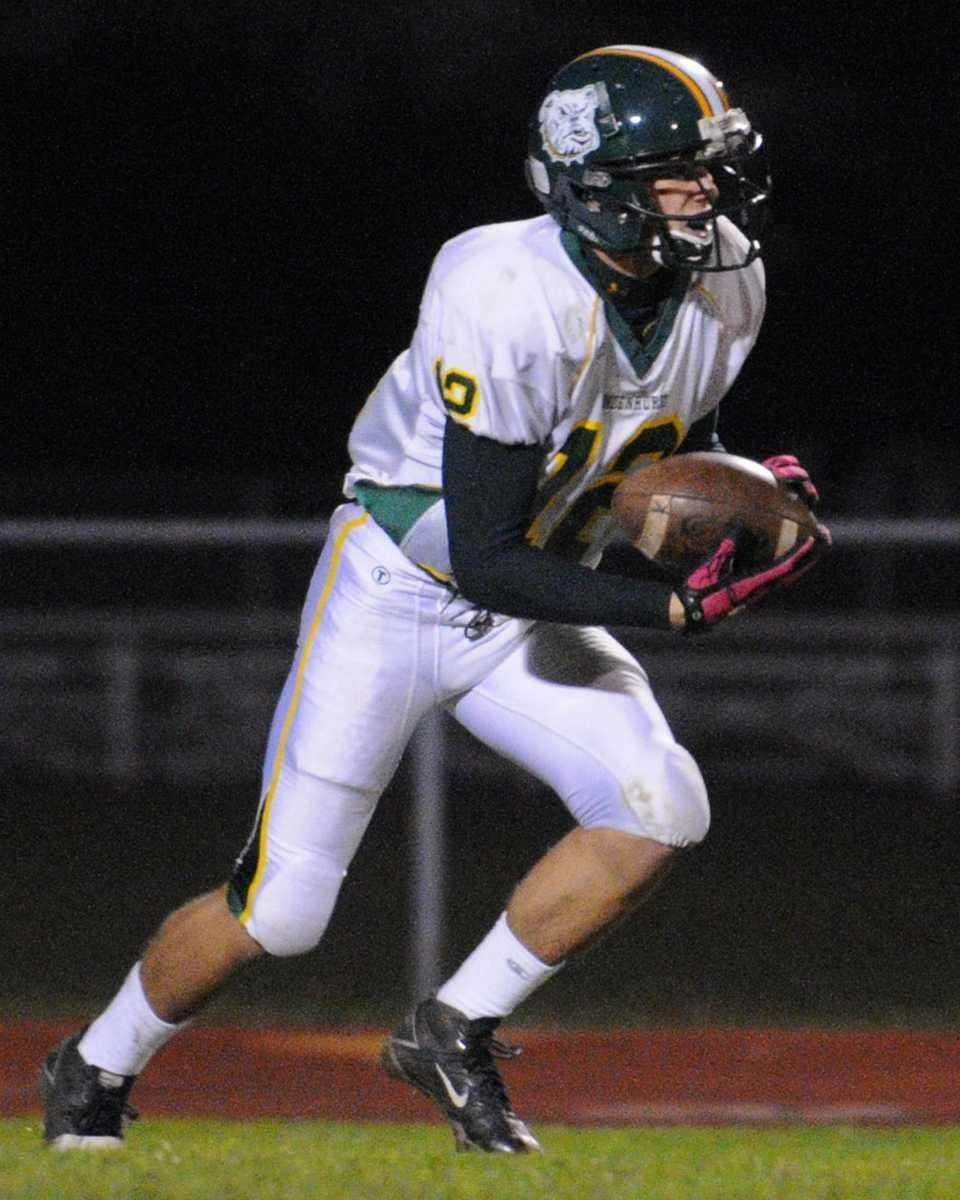 Lindenhurst High School's David George returns a kick