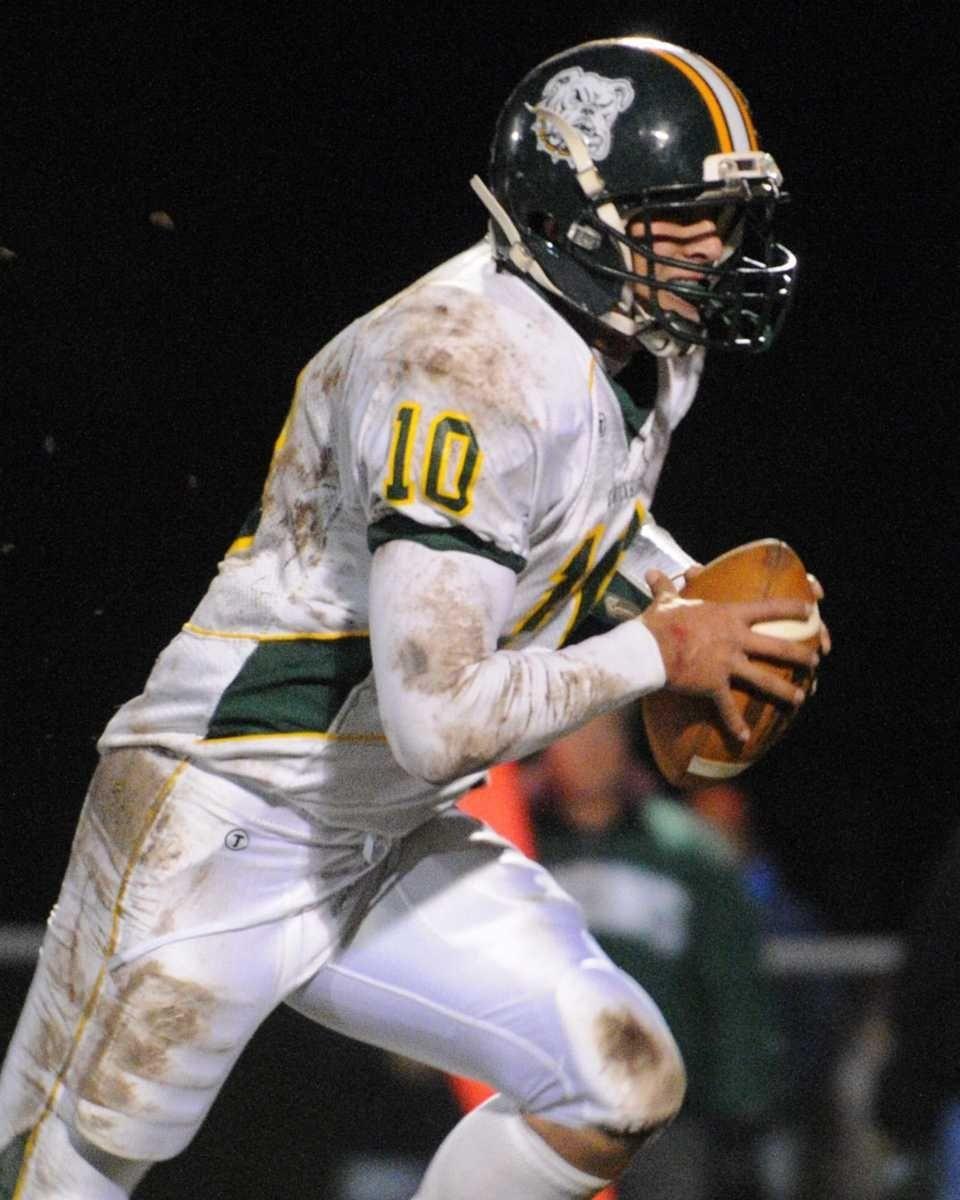 Lindenhurst High School quarterback Stephen Skon scrambles