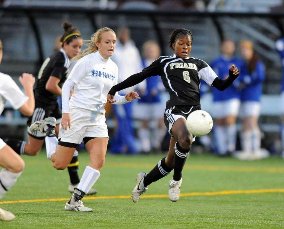 St. Anthony's Ashley Small races past Erica Berry