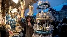 A visitor looks at decorations at the Christmas