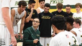 Ward Melville head coach Alex Piccirillo directs his