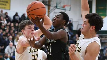 Brentwood's Amari Isaacs is defended by Ward Melville