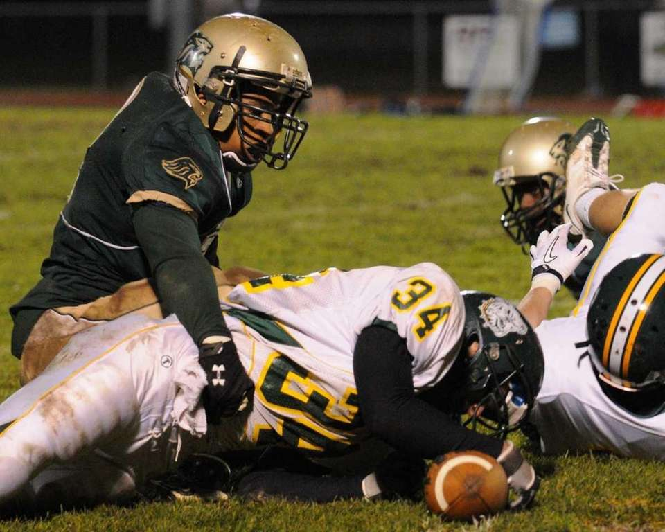 Longwood High School's Cory Wallace, top, tackles Lindenhurst