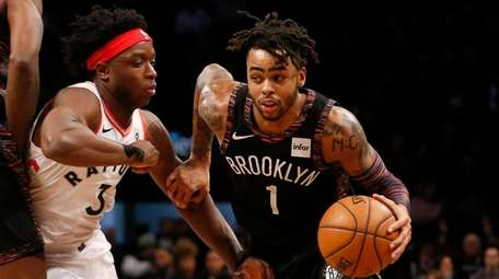D'Angelo Russell #1 of the Brooklyn Nets drives