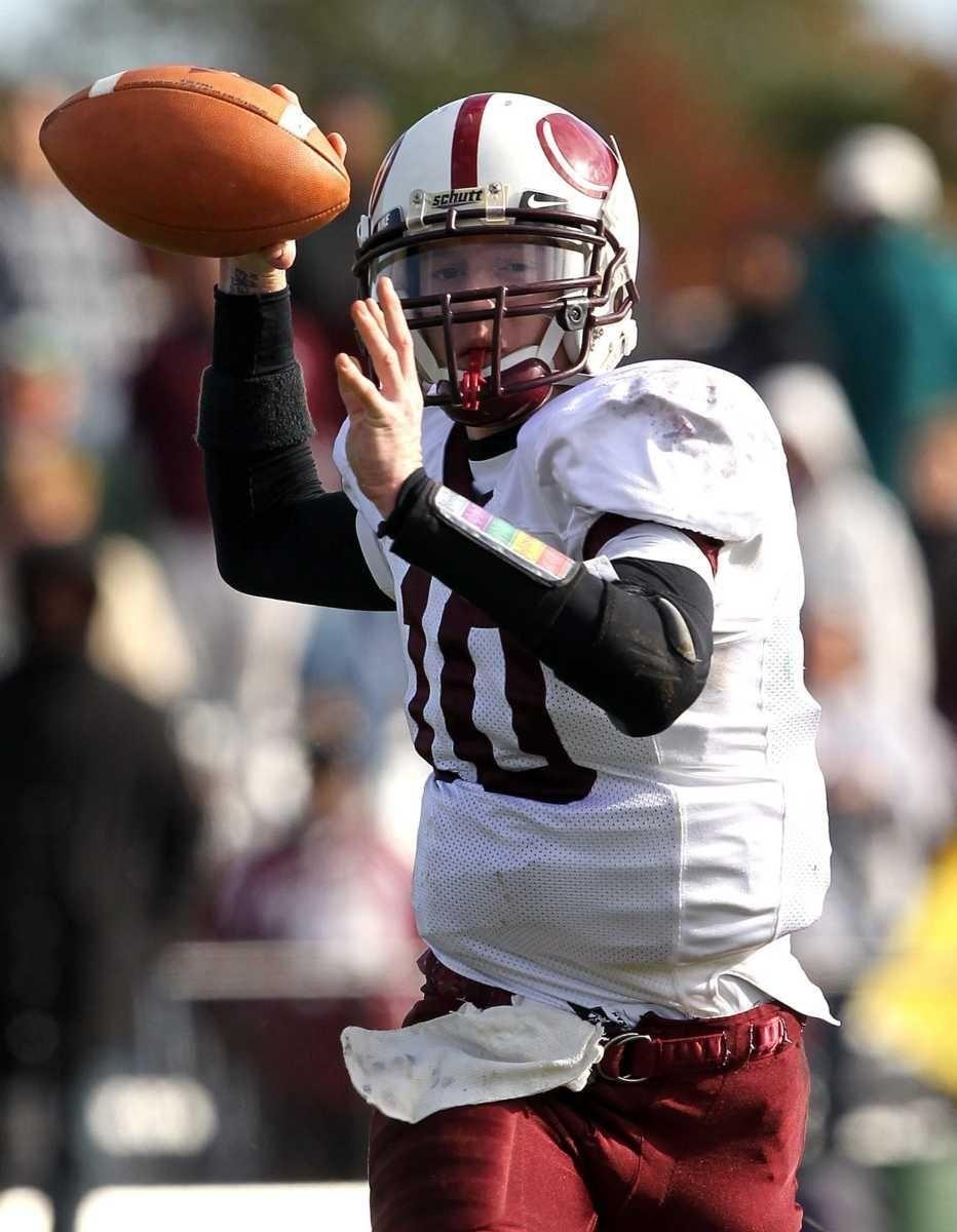 Bay Shore quarterback Kevin Cox (10) steps up